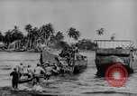 Image of US Soldiers labor and haul equipment Pacific Theater, 1944, second 8 stock footage video 65675056745