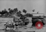 Image of US Soldiers labor and haul equipment Pacific Theater, 1944, second 9 stock footage video 65675056745