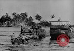 Image of US Soldiers labor and haul equipment Pacific Theater, 1944, second 10 stock footage video 65675056745