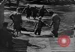 Image of US Soldiers labor and haul equipment Pacific Theater, 1944, second 11 stock footage video 65675056745