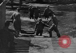 Image of US Soldiers labor and haul equipment Pacific Theater, 1944, second 12 stock footage video 65675056745