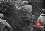 Image of US Army soldiers and Marines in combat World War 2 Pacific Theater, 1944, second 5 stock footage video 65675056746