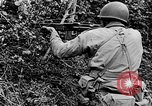 Image of US Army soldiers and Marines in combat World War 2 Pacific Theater, 1944, second 10 stock footage video 65675056746