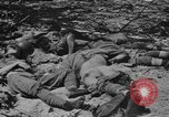 Image of US and enemy soldiers killed in World War 2 Pacific Theater, 1944, second 10 stock footage video 65675056749
