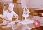 Image of Tricia's wedding cake preparation Washington DC USA, 1971, second 1 stock footage video 65675056994
