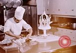 Image of Tricia's wedding cake preparation Washington DC USA, 1971, second 2 stock footage video 65675056994