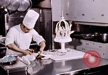 Image of Tricia's wedding cake preparation Washington DC USA, 1971, second 3 stock footage video 65675056994