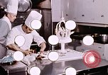 Image of Tricia's wedding cake preparation Washington DC USA, 1971, second 4 stock footage video 65675056994