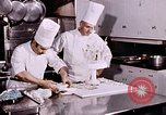 Image of Tricia's wedding cake preparation Washington DC USA, 1971, second 6 stock footage video 65675056994