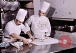 Image of Tricia's wedding cake preparation Washington DC USA, 1971, second 8 stock footage video 65675056994