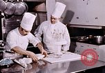 Image of Tricia's wedding cake preparation Washington DC USA, 1971, second 9 stock footage video 65675056994