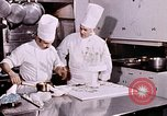 Image of Tricia's wedding cake preparation Washington DC USA, 1971, second 10 stock footage video 65675056994