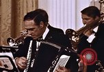 Image of orchestra at wedding Washington DC USA, 1971, second 9 stock footage video 65675056996