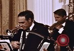 Image of orchestra at wedding Washington DC USA, 1971, second 11 stock footage video 65675056996