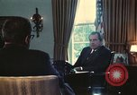 Image of Nixon talking to Kissinger in Oval Office Paris France, 1973, second 6 stock footage video 65675057083