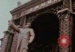 Image of Mao statue and arch Shanghai China, 1972, second 1 stock footage video 65675057344