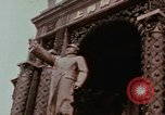 Image of Mao statue and arch Shanghai China, 1972, second 2 stock footage video 65675057344