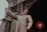 Image of Mao statue and arch Shanghai China, 1972, second 4 stock footage video 65675057344