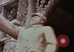 Image of Mao statue and arch Shanghai China, 1972, second 5 stock footage video 65675057344