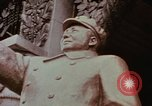 Image of Mao statue and arch Shanghai China, 1972, second 6 stock footage video 65675057344