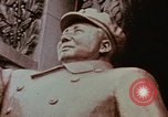 Image of Mao statue and arch Shanghai China, 1972, second 7 stock footage video 65675057344