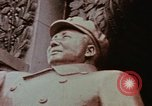 Image of Mao statue and arch Shanghai China, 1972, second 8 stock footage video 65675057344