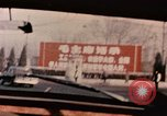 Image of Nixon motorcade in snow China, 1972, second 11 stock footage video 65675057373