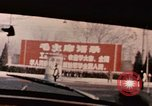Image of Nixon motorcade in snow China, 1972, second 12 stock footage video 65675057373