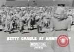 Image of Betty Grable at Army Camp Pacific Theater, 1942, second 1 stock footage video 65675057630