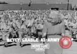 Image of Betty Grable at Army Camp Pacific Theater, 1942, second 2 stock footage video 65675057630