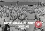 Image of Betty Grable at Army Camp Pacific Theater, 1942, second 4 stock footage video 65675057630