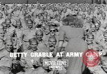 Image of Betty Grable at Army Camp Pacific Theater, 1942, second 5 stock footage video 65675057630
