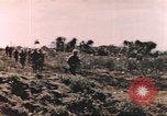 Image of US soldier assists wounded tank driver Iwo Jima Iwo Jima, 1945, second 5 stock footage video 65675057724