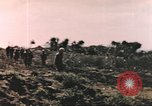 Image of US soldier assists wounded tank driver Iwo Jima Iwo Jima, 1945, second 10 stock footage video 65675057724