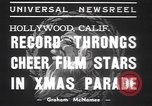 Hollywood stars Mickey Rooney, Tom Mix, and Edgar Bergen participate in a Christmas parade in Hollywood, California.