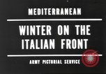 Image of snow covered area Italy, 1944, second 1 stock footage video 65675057850