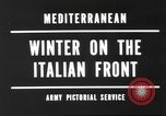 Image of snow covered area Italy, 1944, second 3 stock footage video 65675057850