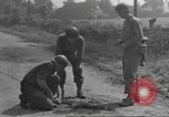 Image of soldier defusing a German Teller mine Pont Bellenger France, 1944, second 6 stock footage video 65675057863