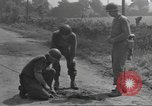 Image of soldier defusing a German Teller mine Pont Bellenger France, 1944, second 7 stock footage video 65675057863