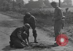 Image of soldier defusing a German Teller mine Pont Bellenger France, 1944, second 8 stock footage video 65675057863