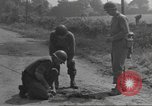Image of soldier defusing a German Teller mine Pont Bellenger France, 1944, second 10 stock footage video 65675057863