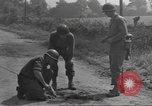 Image of soldier defusing a German Teller mine Pont Bellenger France, 1944, second 12 stock footage video 65675057863