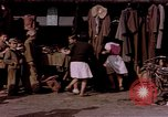 Image of market place Japan, 1945, second 8 stock footage video 65675057893