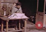 Image of market place Japan, 1945, second 11 stock footage video 65675057893