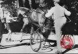 Image of horse and buggy race Vienna Austria, 1943, second 7 stock footage video 65675057926