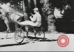Image of horse and buggy race Vienna Austria, 1943, second 9 stock footage video 65675057926
