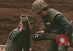 Image of Marines refueling UH-1E Iroquois helicopters Khe Sanh Vietnam, 1968, second 5 stock footage video 65675058028