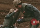 Image of Marines refueling UH-1E Iroquois helicopters Khe Sanh Vietnam, 1968, second 6 stock footage video 65675058028