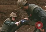 Image of Marines refueling UH-1E Iroquois helicopters Khe Sanh Vietnam, 1968, second 7 stock footage video 65675058028