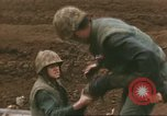 Image of Marines refueling UH-1E Iroquois helicopters Khe Sanh Vietnam, 1968, second 9 stock footage video 65675058028